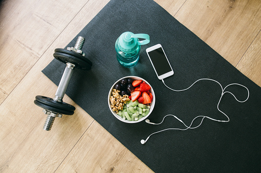 Food and Drink「Dumbbell, drinking bottle, fruit bowl and smartphone with earphones」:スマホ壁紙(3)