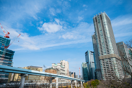 Shiodome「New Transit Yurikamome runs on Elevated Railway among the high-rise office buildings at Shiodome Tokyo Japan.」:スマホ壁紙(7)