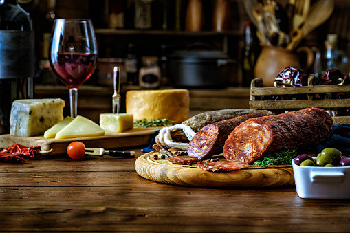 Parma Ham「Tapas of cheese, cured ham, salami wine and chorizo on a rustic wooden table」:スマホ壁紙(7)