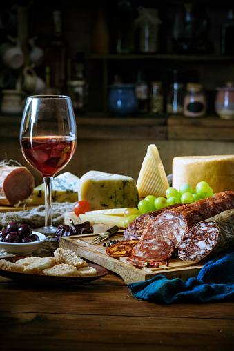 Cutting Board「Tapas of cheese, cured ham, salami wine and chorizo on a rustic wooden table」:スマホ壁紙(10)
