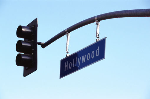 Boulevard「Traffic light with Hollywood sign against sky, low angle view」:スマホ壁紙(1)