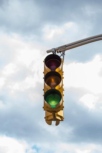Stoplight「Traffic light against storm clouds」:スマホ壁紙(12)