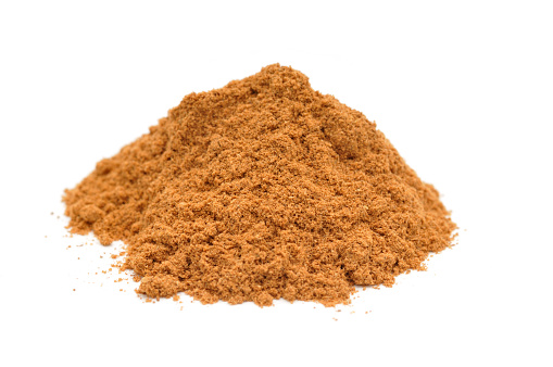 Cinnamon「Pile of ground cinnamon on white background」:スマホ壁紙(17)