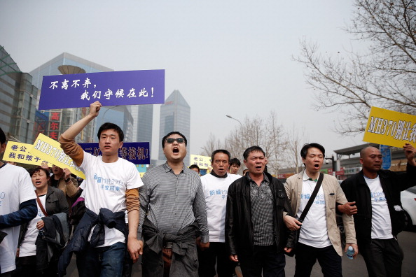 Lintao Zhang「Relatives Of Missing Flight MH370 Passengers March On Malaysian Embassy In Beijing」:写真・画像(14)[壁紙.com]