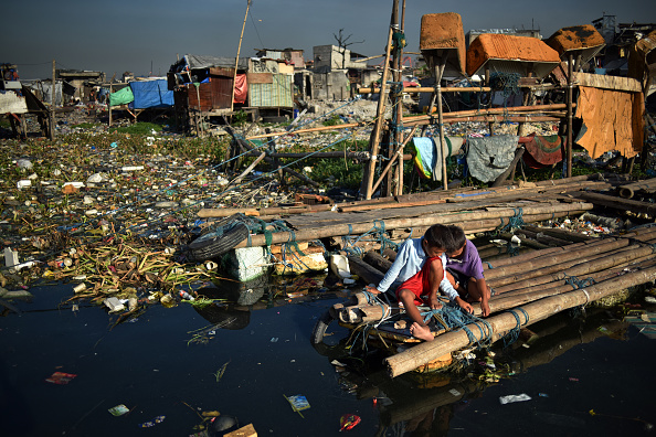 Social Issues「Filipinos Slum Dwellers Risk Rising Waters At Manila's Coast」:写真・画像(12)[壁紙.com]