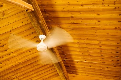 Ceiling Fan「Ceiling fan turning in a log cabin」:スマホ壁紙(12)