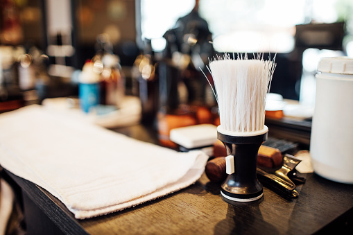 Buenos Aires「Close-up of shaving brush on table in barbershop」:スマホ壁紙(19)