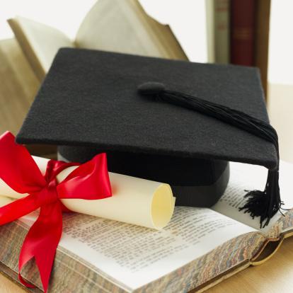 Graduation「Close-up of a graduation cap and a diploma with ribbon and a textbook」:スマホ壁紙(1)