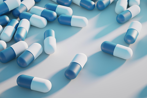 Allergy Medicine「Close-up of a large group of capsule pills on a white background.」:スマホ壁紙(1)