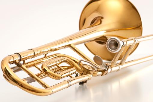 Trombone「A closeup of the back of a golden trombone」:スマホ壁紙(7)