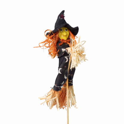 魔女「close-up of a witch figurine」:スマホ壁紙(18)