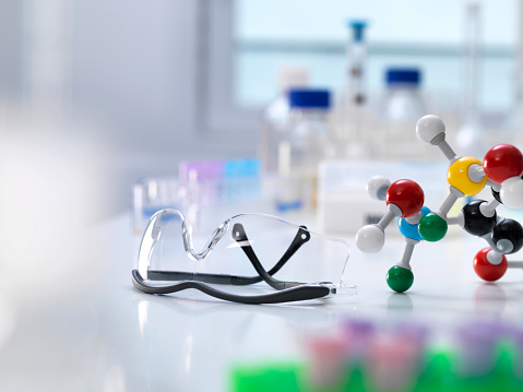 Eyewear「Close-up of molecular structure with protective eyewear on table in laboratory」:スマホ壁紙(2)