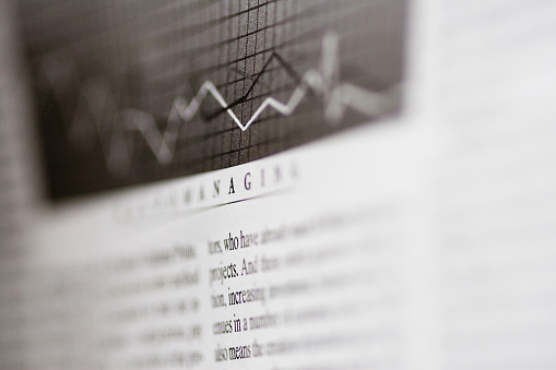 Guidance「Close-up of a stock market article」:スマホ壁紙(1)