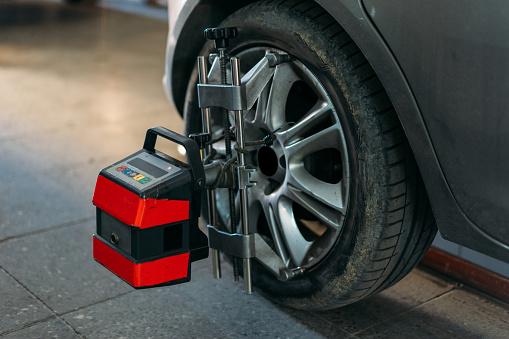 Convex「Closeup of tire clamped with aligner undergoing auto wheel align」:スマホ壁紙(5)