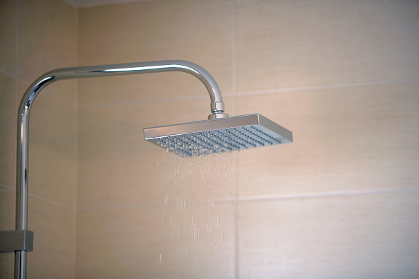 Bathroom「Close-up of a stainless steel shower with tiled wall」:写真・画像(4)[壁紙.com]