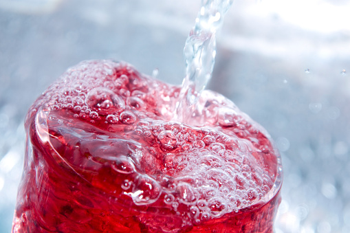 Pouring「Close-up of a bubbly red drink」:スマホ壁紙(14)
