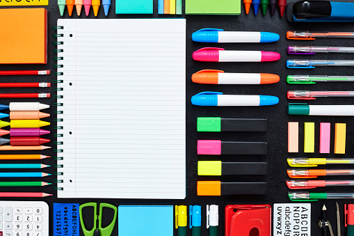 Surrounding「Close-up of spiral notepad surrounded by school supplies on blac」:スマホ壁紙(7)