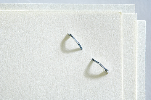 Corner「Close-up of Stapled Paper」:スマホ壁紙(2)