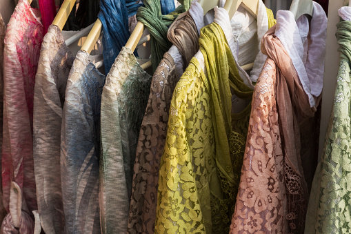 Yellow Dress「Close-up of colorful cotton lace dresses with scarves on a store clothes rack,」:スマホ壁紙(10)
