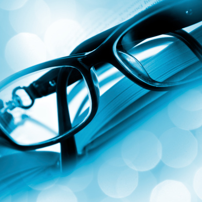 Horn Rimmed Glasses「Close-up of glasses on open book in moody blue colour」:スマホ壁紙(7)