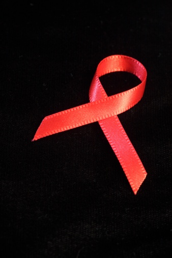 A Helping Hand「Close-up of an Aids Ribbon Against a Black Background」:スマホ壁紙(12)