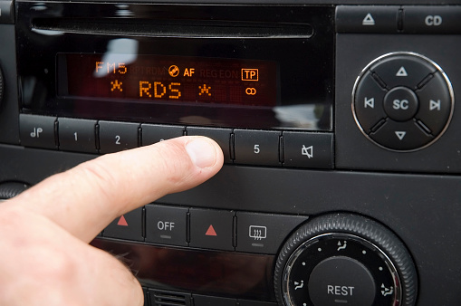 Choosing「Close-up of finger adjusting car radio system」:スマホ壁紙(4)
