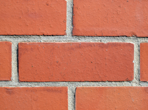 Brick Wall「Close-up of a red brick wall with emphasis on one brick」:スマホ壁紙(1)