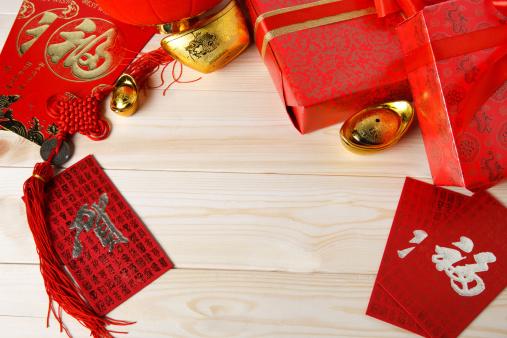Ancient Civilization「Close-up of gold ingots and red envelopes」:スマホ壁紙(11)