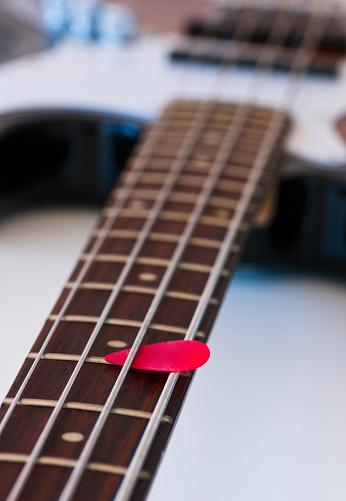 Bass Instrument「Close-up of bass guitar with guitar pick」:スマホ壁紙(3)