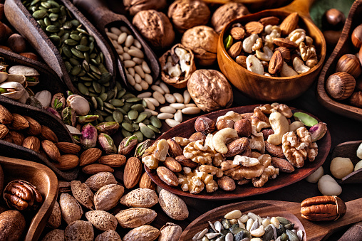 Pine Nut「Close-up of a variety of dried fruit and nuts on a table in a old fashioned rustic kitchen」:スマホ壁紙(11)
