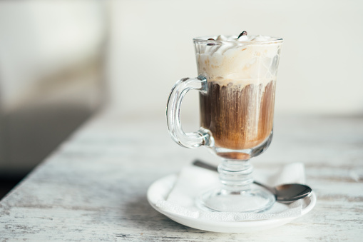 Indulgence「Close-up of an Irish coffee on a wooden table」:スマホ壁紙(14)