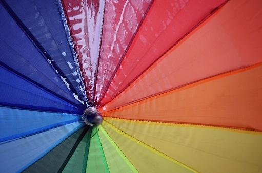 Umbrella「Close-up of a wet multi-colored umbrella」:スマホ壁紙(2)