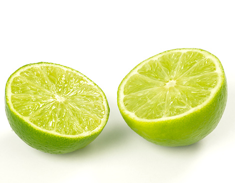 Cross Section「Close-up of two lime halves isolated on white」:スマホ壁紙(15)