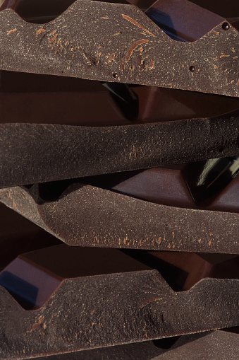 Chocolate Bar「Close-up of broken pieces of dark chocolate in stack.」:スマホ壁紙(2)