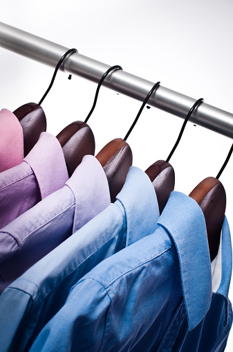 Formalwear「Close-up of pink, blue button down shirts hanging on hangers」:スマホ壁紙(13)