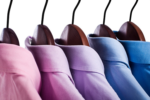 Formalwear「Close-up of pink, blue button down shirts hanging on hangers」:スマホ壁紙(11)