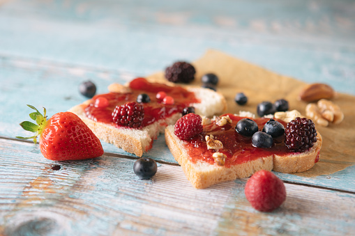 Toasted Food「Close-up of toast with homemade strawberry jam on table - Stock image...」:スマホ壁紙(11)