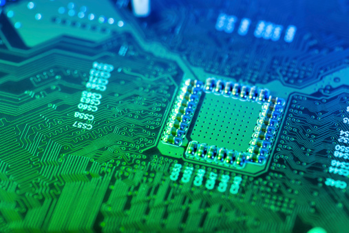 CPU「A closeup of a green and blue computer circuit board」:スマホ壁紙(19)