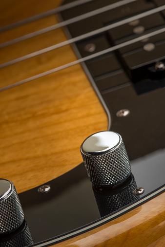 Bass Instrument「Close-up of volume and tone control of bass guitar」:スマホ壁紙(2)