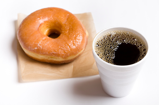 Glazed Food「Close-up of a cup of black coffee and a glazed donut」:スマホ壁紙(10)