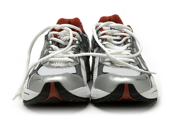 Close-up of a pair of silver running shoes:スマホ壁紙(壁紙.com)