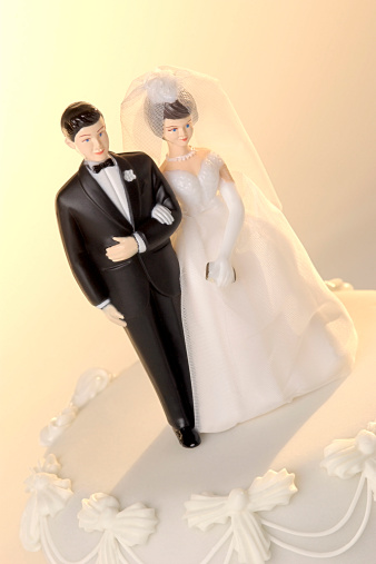 Married「Close-up of wedding cake with a miniature bride and groom cake topper」:スマホ壁紙(10)