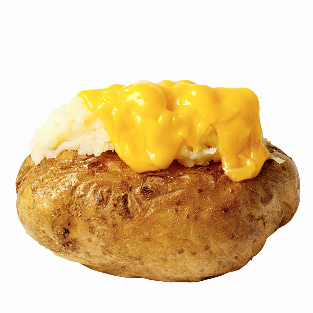Close-up of a baked potato with cheese:スマホ壁紙(壁紙.com)