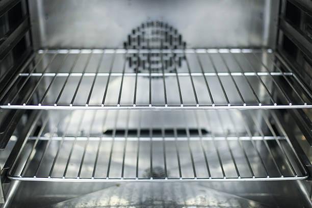 A close-up of the interior of a clean oven:スマホ壁紙(壁紙.com)