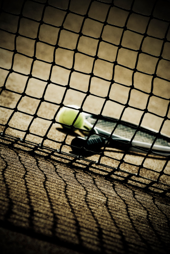 Sepia Toned「Close-up of a tennis racket and tennis ball viewed through the net in a court」:スマホ壁紙(2)