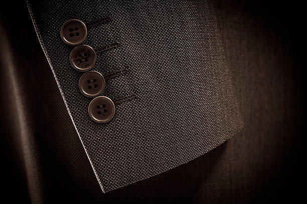 Close-up of suit's sleeve and buttons in brown colour:スマホ壁紙(壁紙.com)
