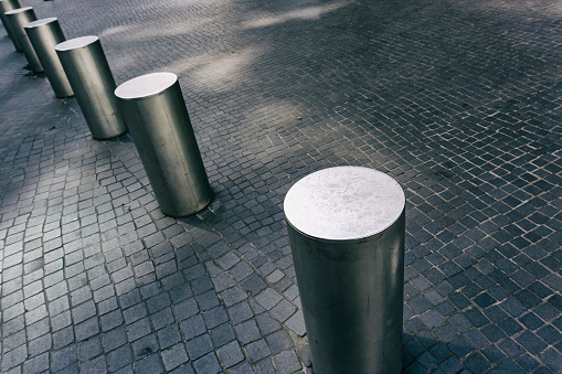 Bollard「Close-Up of Row of Stainless Steel Bollards on Gray Tiled Pavement」:スマホ壁紙(19)