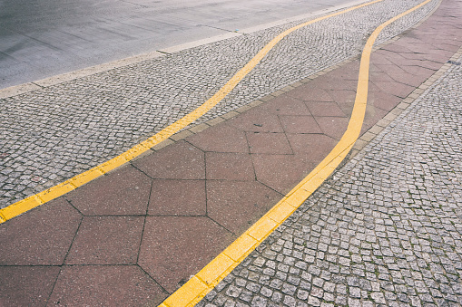 Dividing Line - Road Marking「Close-Up of Yellow Marking Lines on Road」:スマホ壁紙(4)