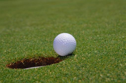 Off Target「Close-Up of a Golf Ball Beside a Hole」:スマホ壁紙(13)