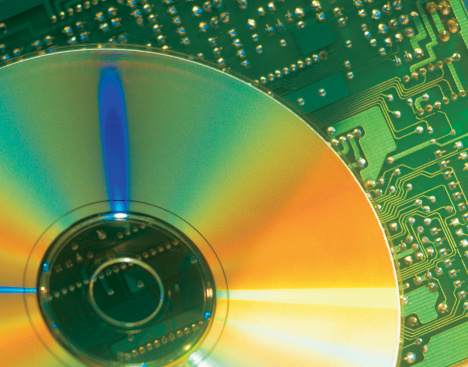 Mother Board「close-up of a compact disc kept on a circuit board」:スマホ壁紙(9)